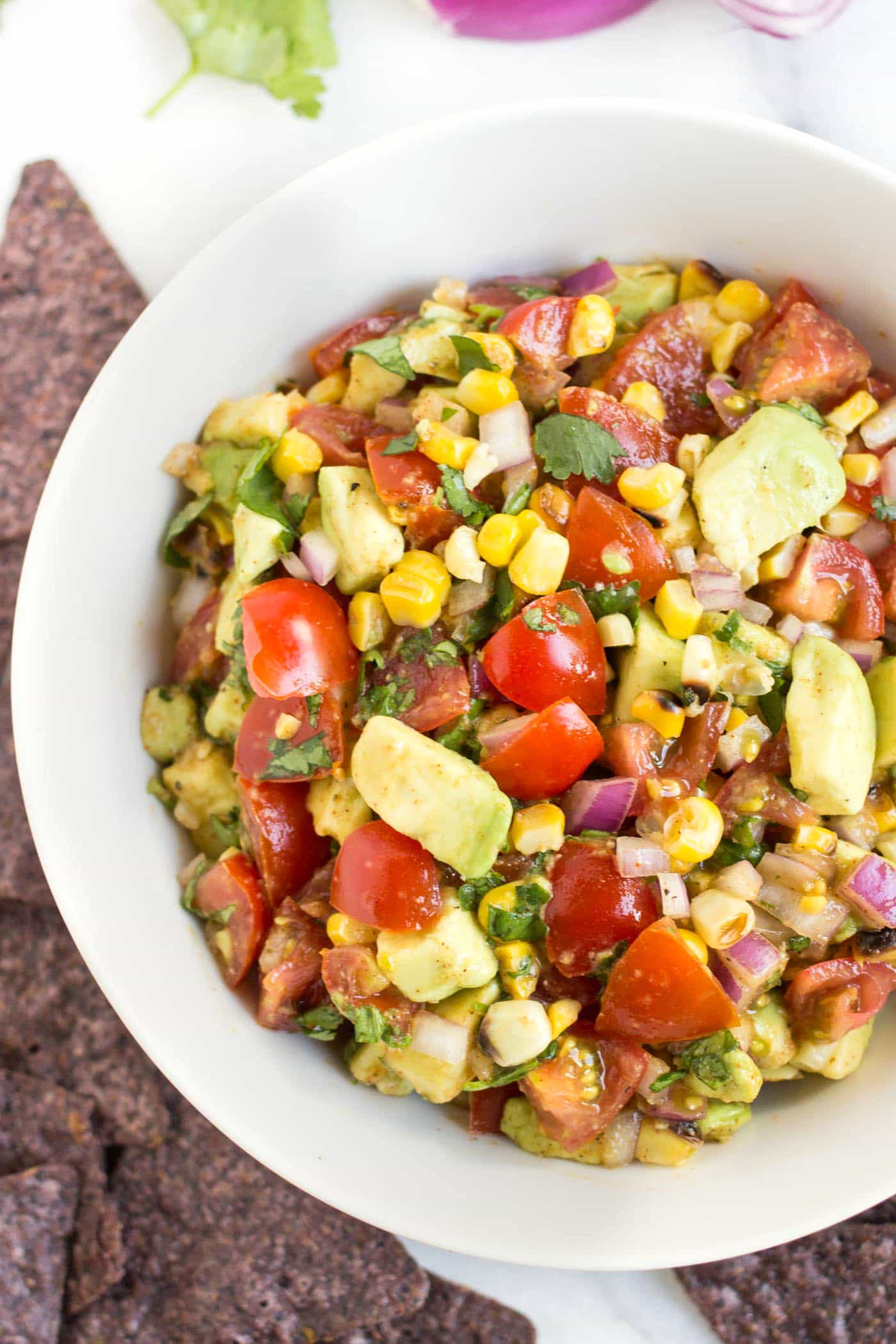 This simple grilled corn + avocado salsa is one of the BEST dips I've ever had!