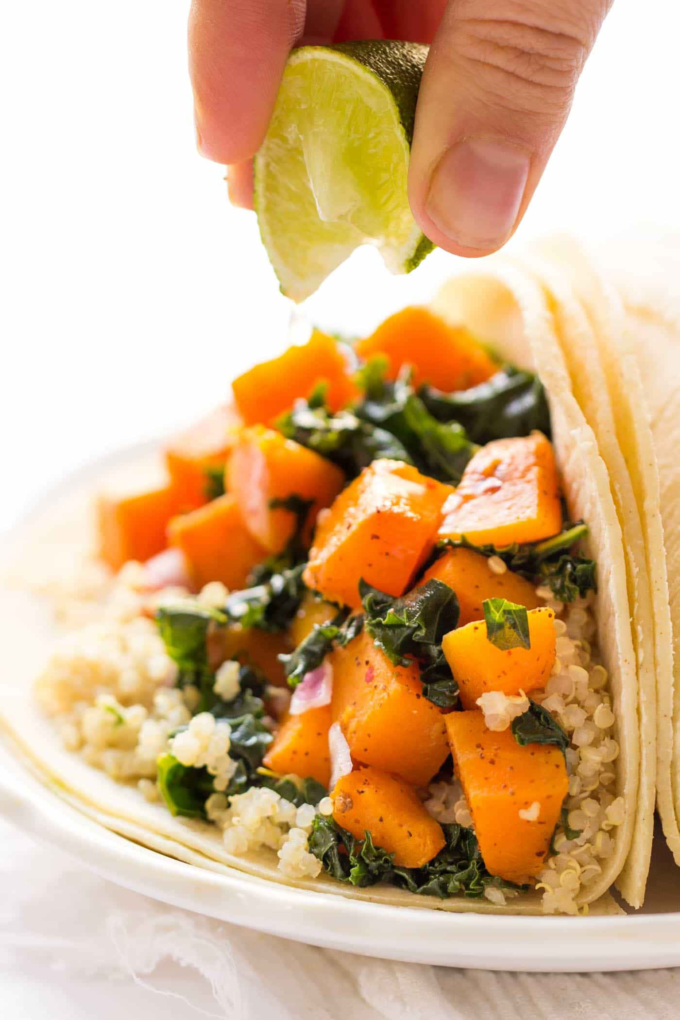 Savory Quinoa Breakfast Tacos -- with chili roasted butternut squash + kale. So simple and SO delicious!