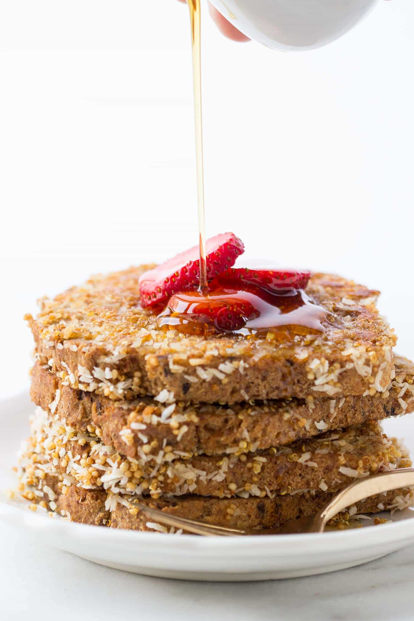 Coconut + Quinoa Crusted Vegan French Toast -- an absolutely EPIC breakfast that requires just 7 HEALTHY ingredients!