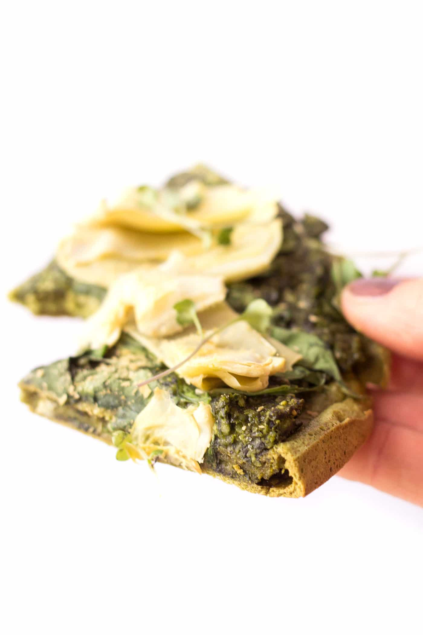 This is the PERFECT slice of pizza --> quinoa pizza crust topped with vegan pesto, spinach + artichokes. Oh my heaven!
