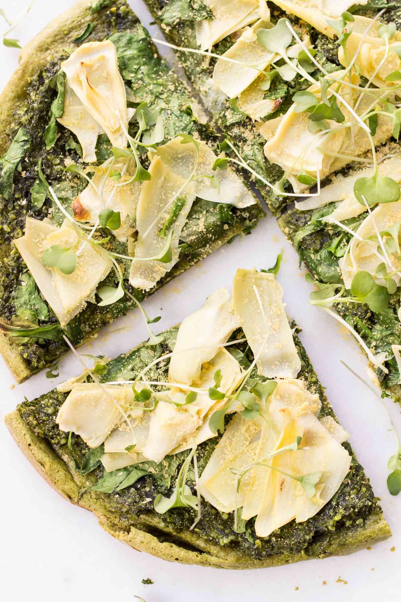 Spinach + Artichoke Quinoa Pizza -- a healthy, vegan pizza that's packed with tons of green veggies!