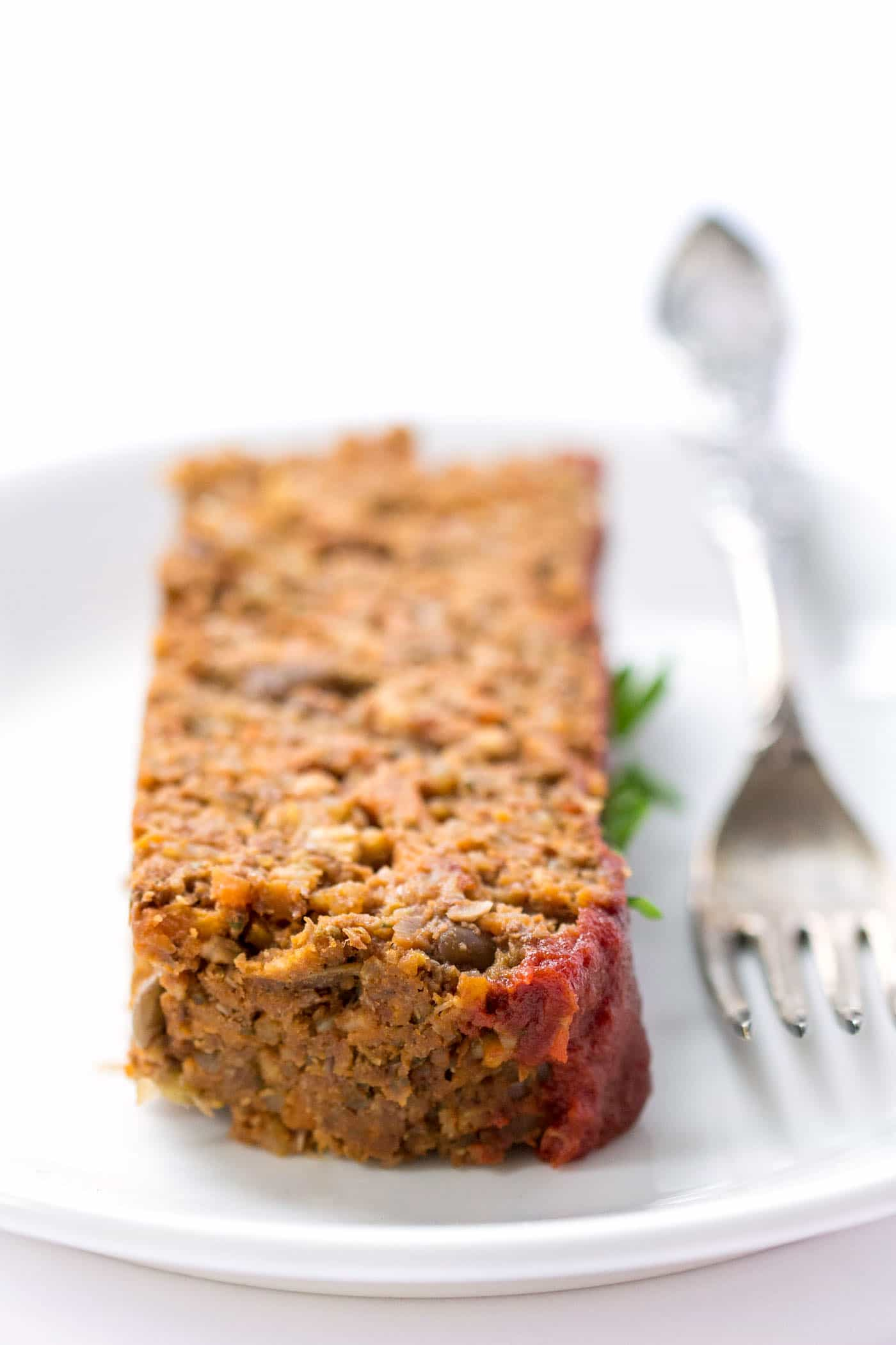 This easy QUINOA MEATLOAF is vegan, gluten-free, packed with protein and veggies, and makes for a healthy and nutritious weeknight meal!