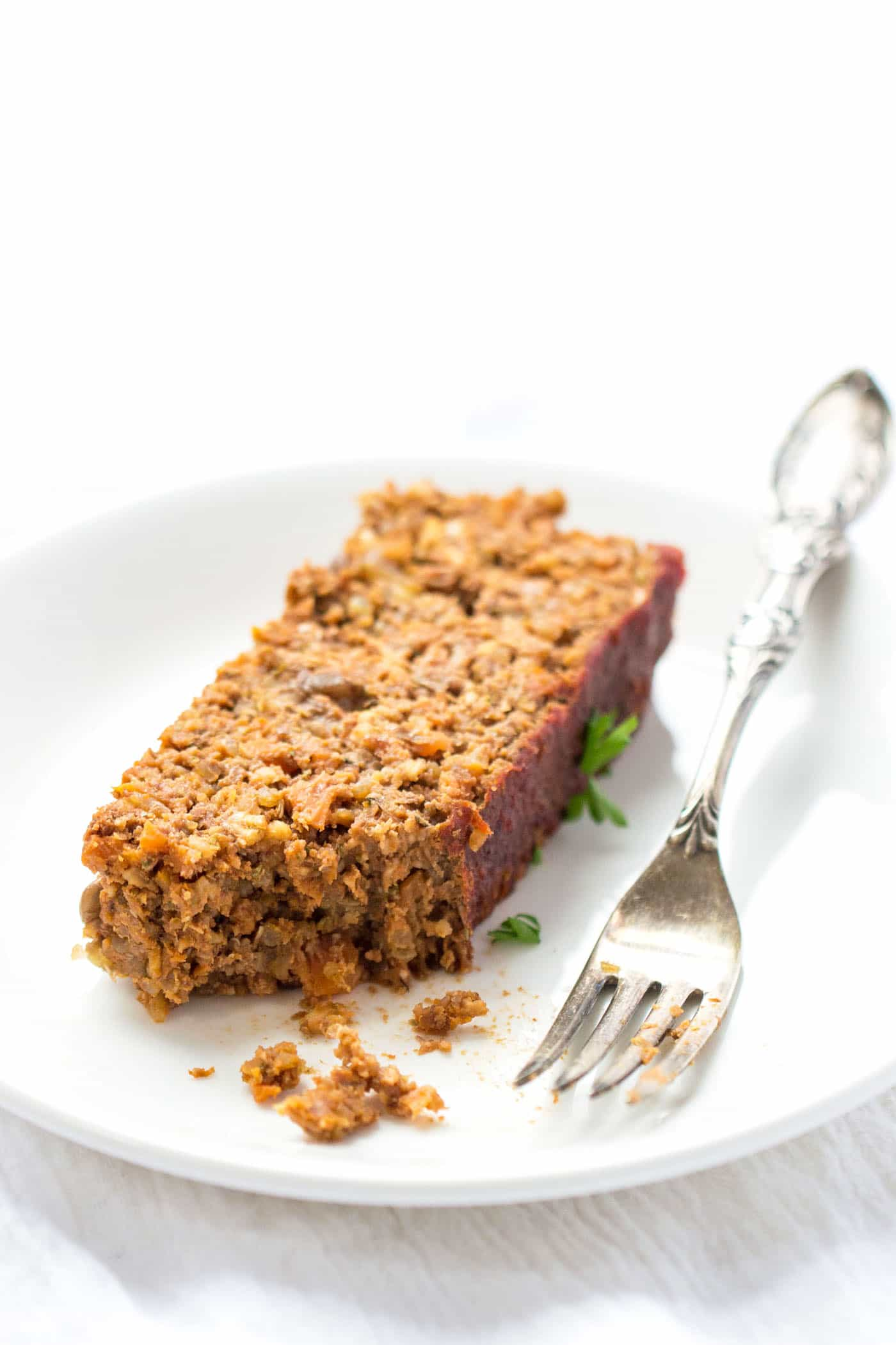LENTIL + QUINOA MEATLOAF -- made with a blend of mushrooms, walnuts, lentils and quinoa, and then smothered in a tomato-maple glaze!