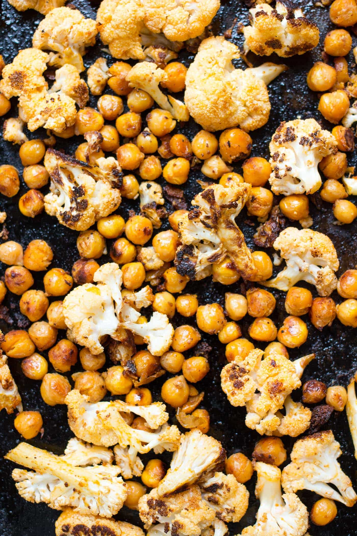 This roasted Buffalo Cauliflower + Chickpea mixture makes the most AMAZING vegan taco filling ever!