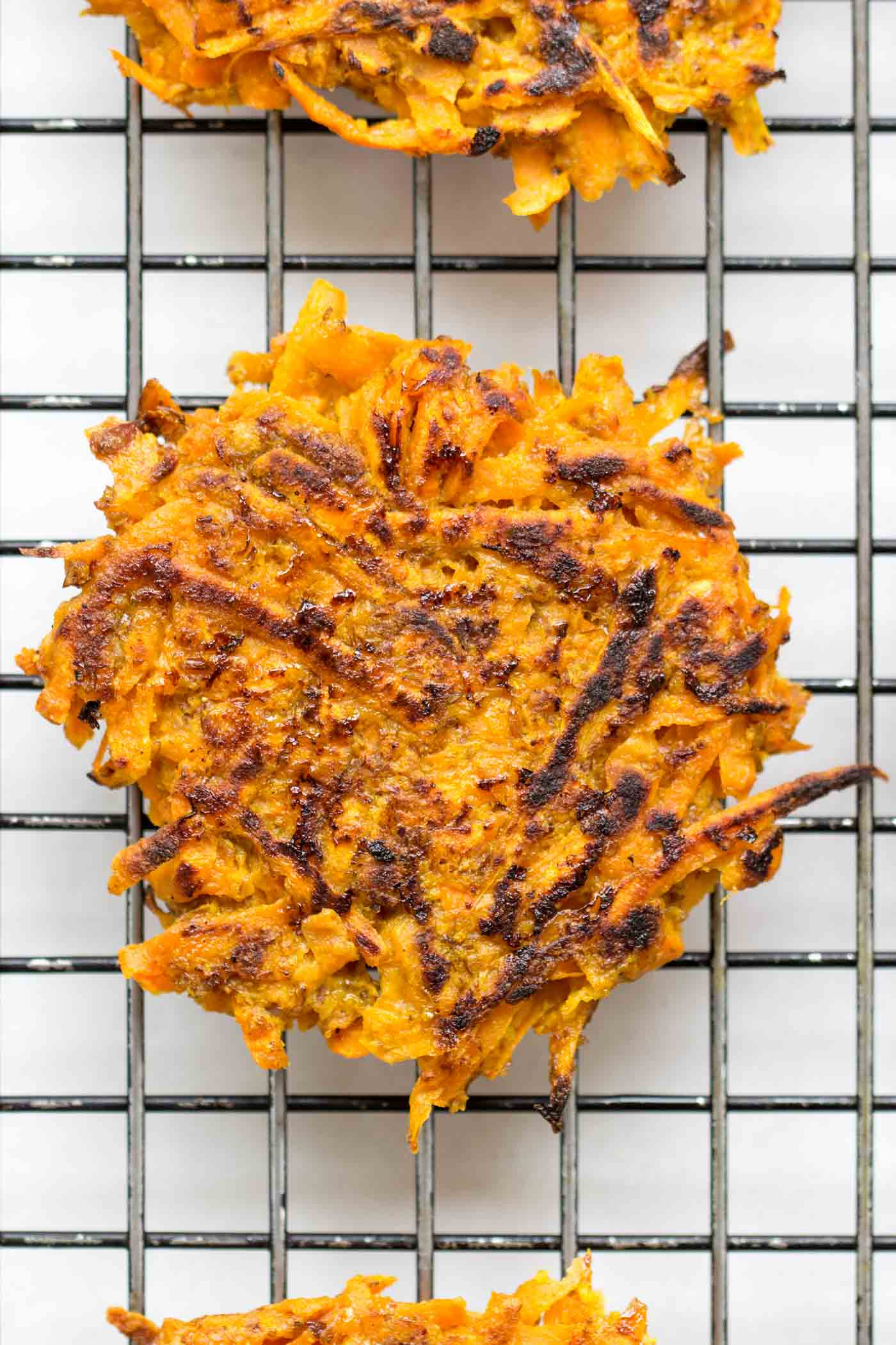 Light, flavorful and perfectly CRISP! These curried carrot + sweet potato fritters are also HEALTHY!