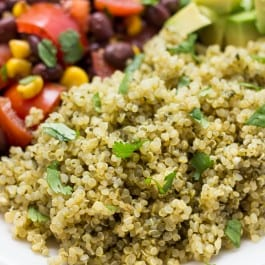 Spicy Green Mexican Quinoa -- a super easy recipe that can be served with pretty much anything! Like Chipotle's Cilantro Lime Rice only BETTER!