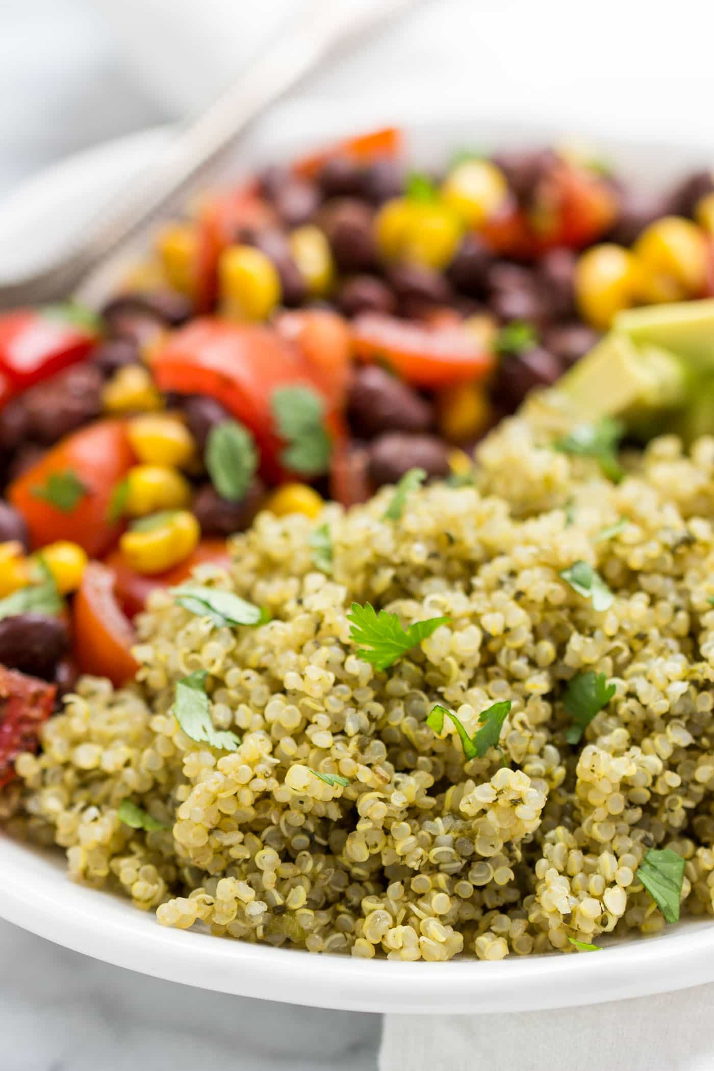 Spicy Green Mexican Quinoa -- cooked with spinach, cilantro, jalapeno, garlic and lime!