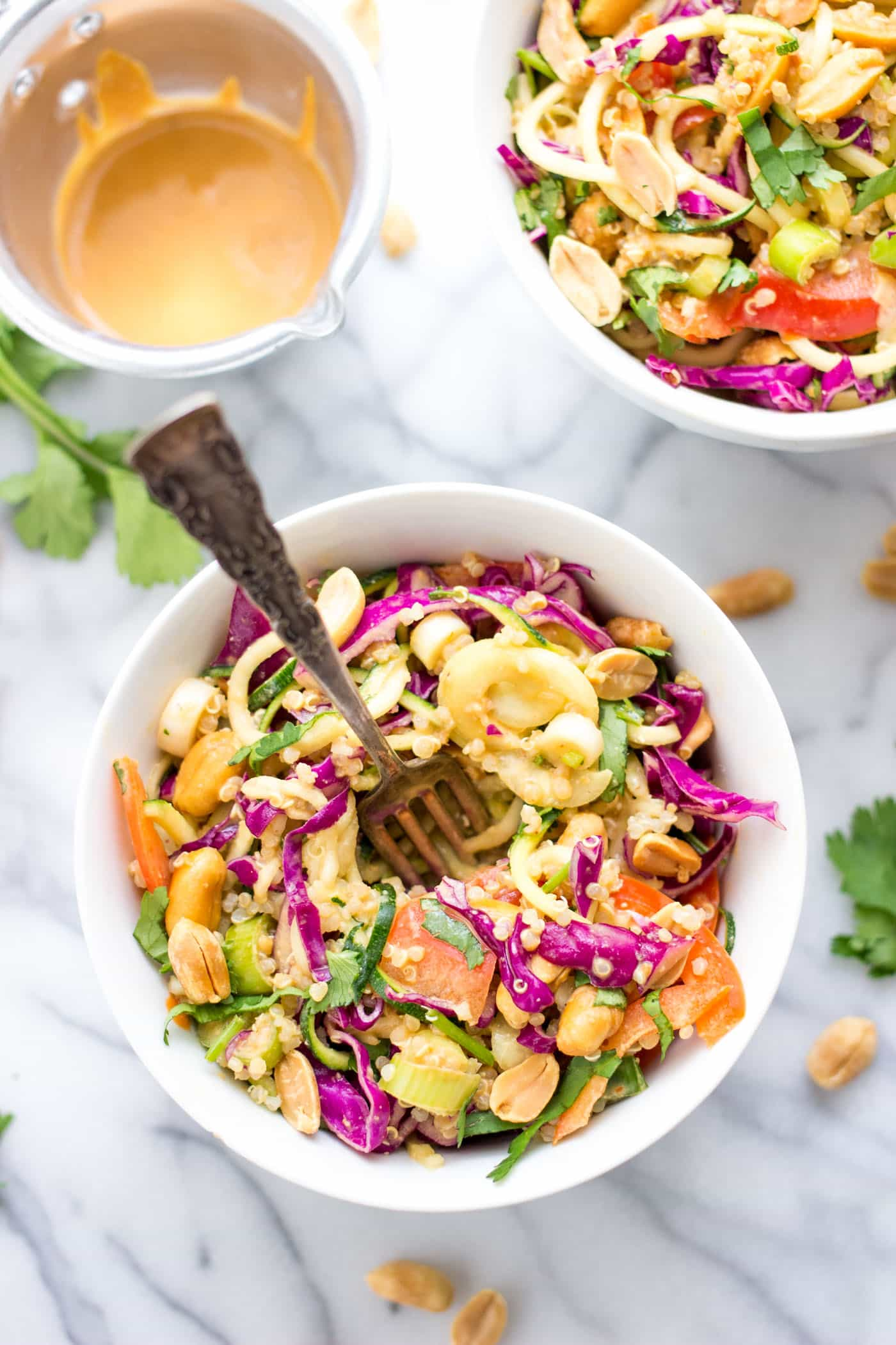 Healthy Pad Thai Zucchini Noodle Salad with veggies, quinoa and a creamy peanut butter sauce. So simple and SO flavorful!