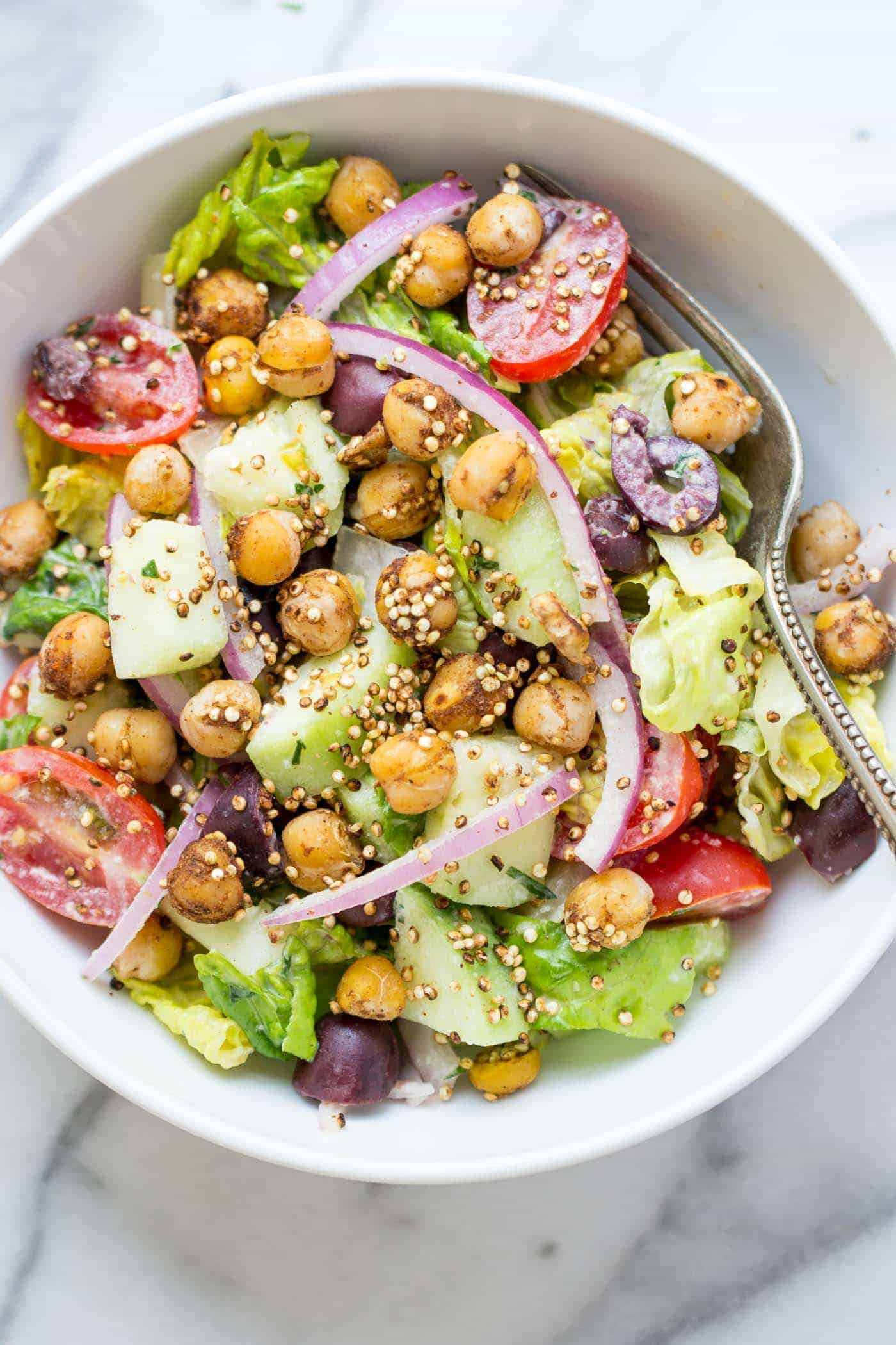 My favorite salad for the summer -- vegan chopped salad with a tarragon tahini dressing AND warm chickpeas!