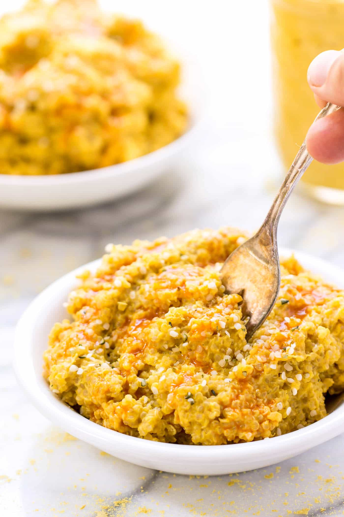 This is the BEST quinoa mac and cheese out there...with a creamy cauliflower buffalo sauce! {vegan + gluten-free}