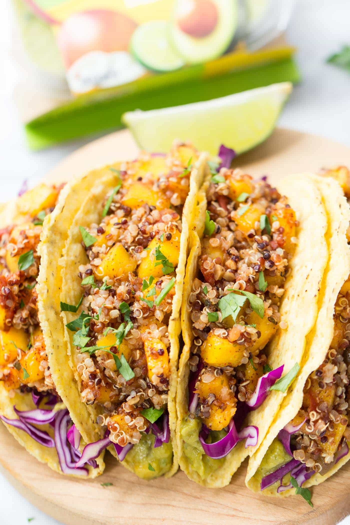 10-MINUTE QUINOA TACOS with a spicy mango-lime filling, red cabbage and creamy guacamole dip on the bottom! [vegan + gluten-free]
