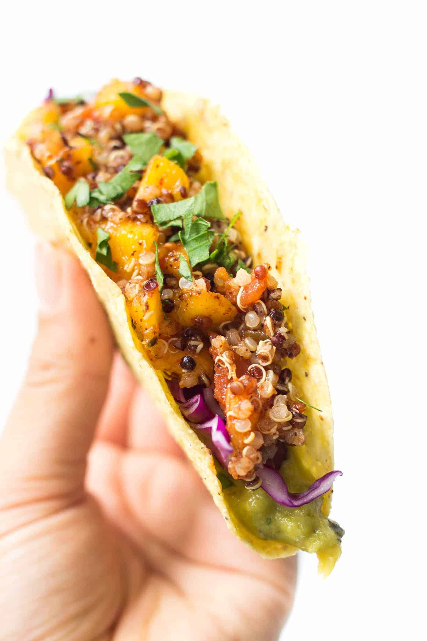 Mango-Lime Quinoa Tacos -- with a spicy meatless filling, creamy guacamole and crunchy red cabbage! So simple and SO HEALTHY! [vegan]