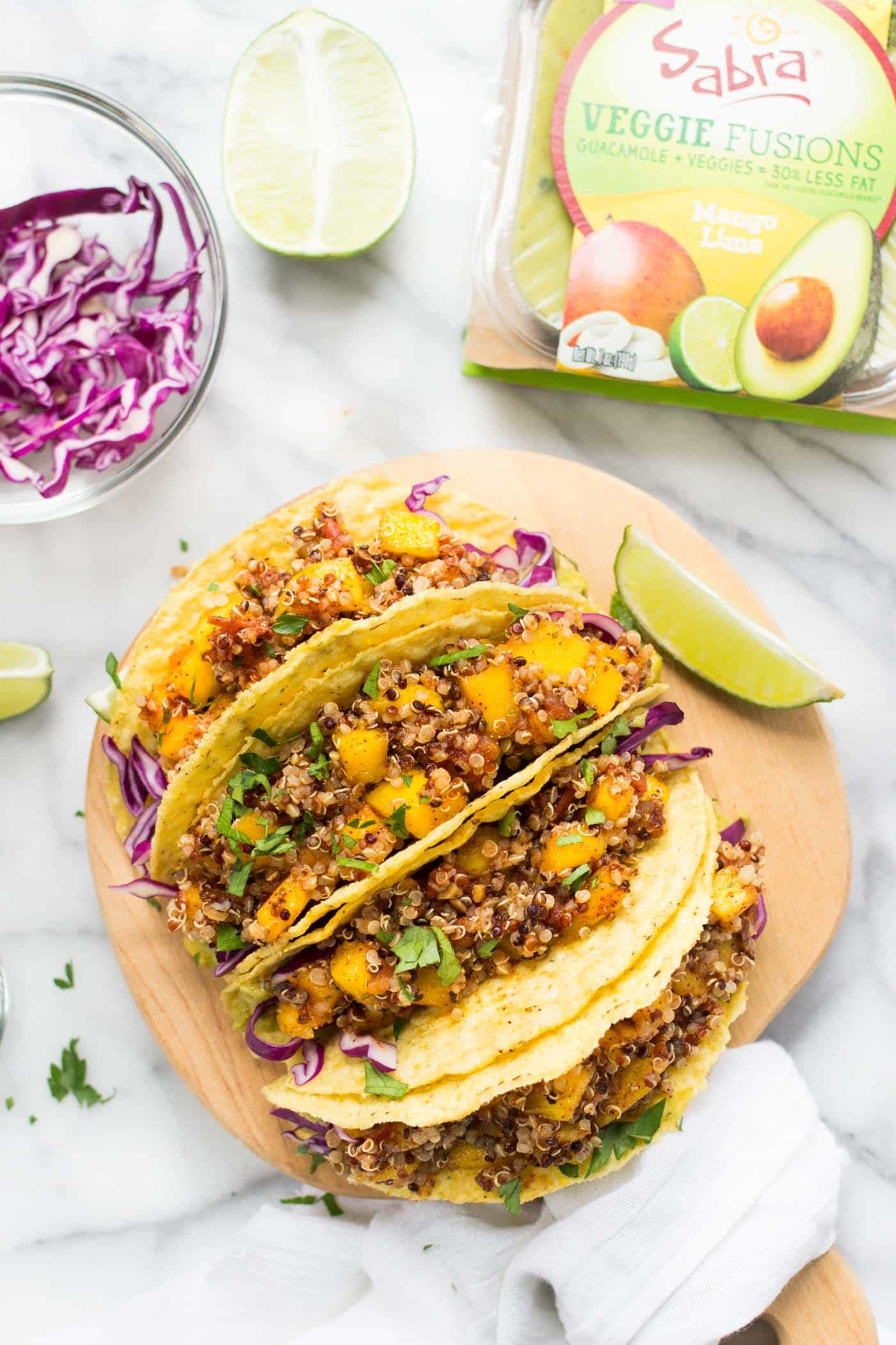VEGAN QUINOA TACOS -- with mango-lime guacamole and a spicy quinoa filling!