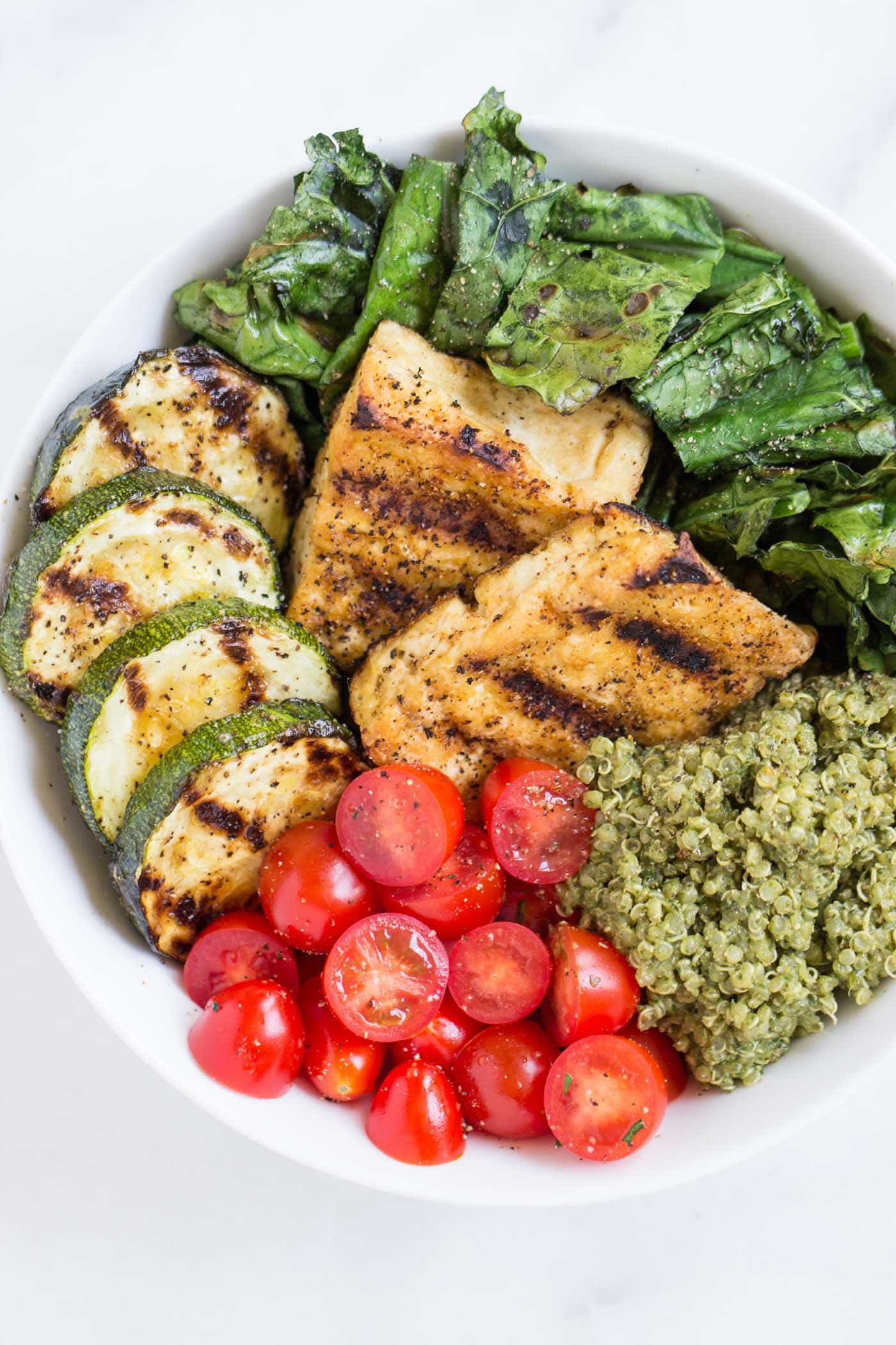 pesto quinoa salad bowls with grilled tofu and zuccini