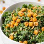 vegan kale caesar salad with crispy chickpeas on top