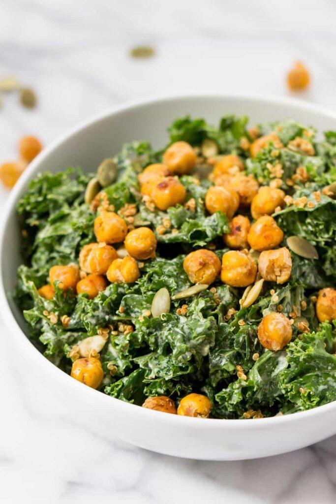 vegan kale caesar salad with crispy chickpeas on top