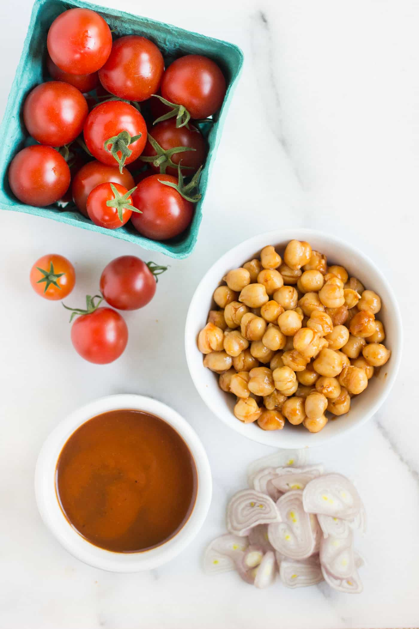 The ultimate BBQ pizza toppings: chickpeas, shallots and cherry tomatoes!