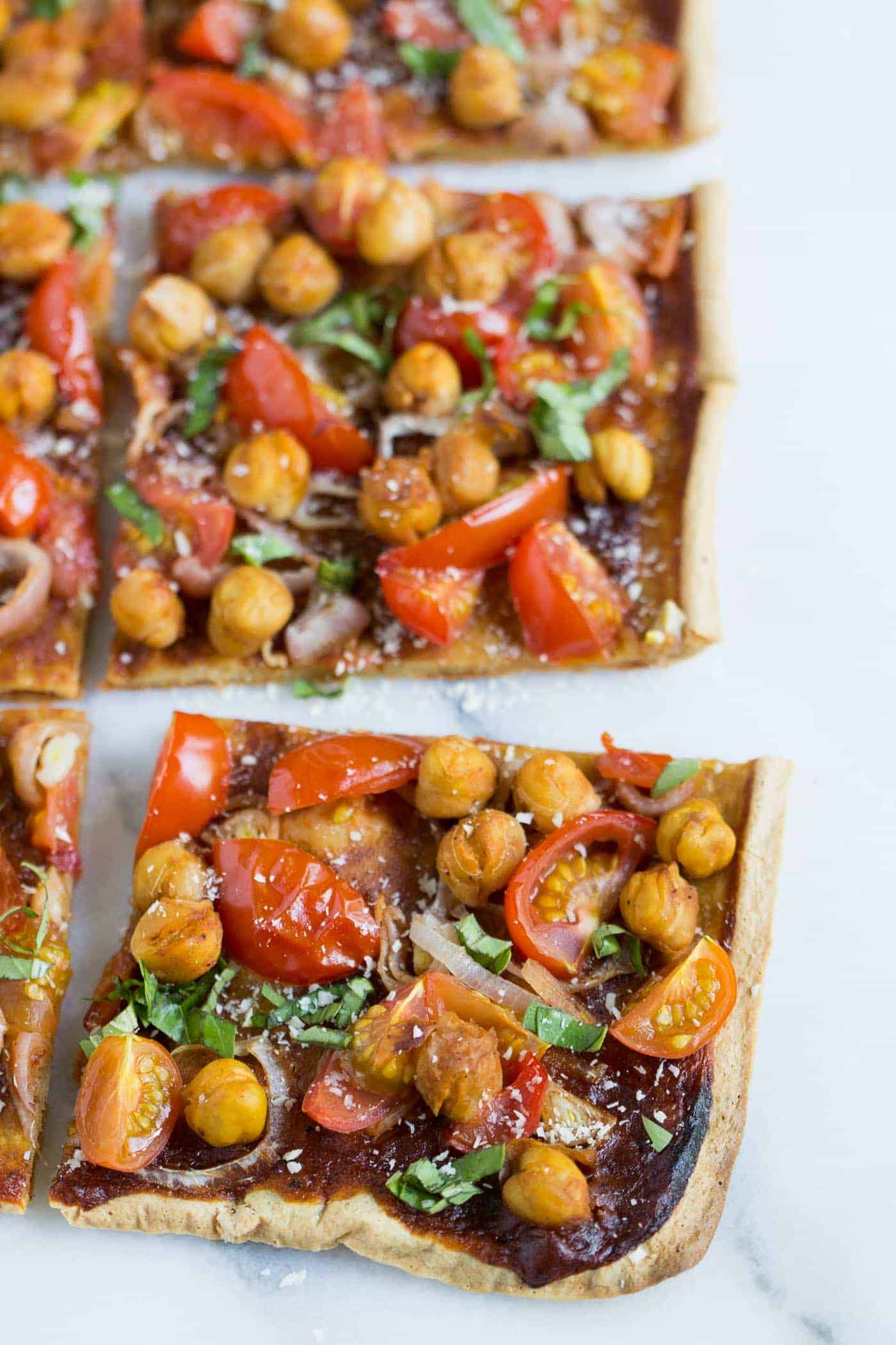 BBQ QUINOA PIZZA topped with shallots, cherry tomatoes and chickpeas! [vegetarian + gluten-free]