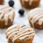 Blackberry Lime Oatmeal Muffins topped with a creamy coconut butter glaze! Naturally gluten-free, without any dairy, oils or eggs!