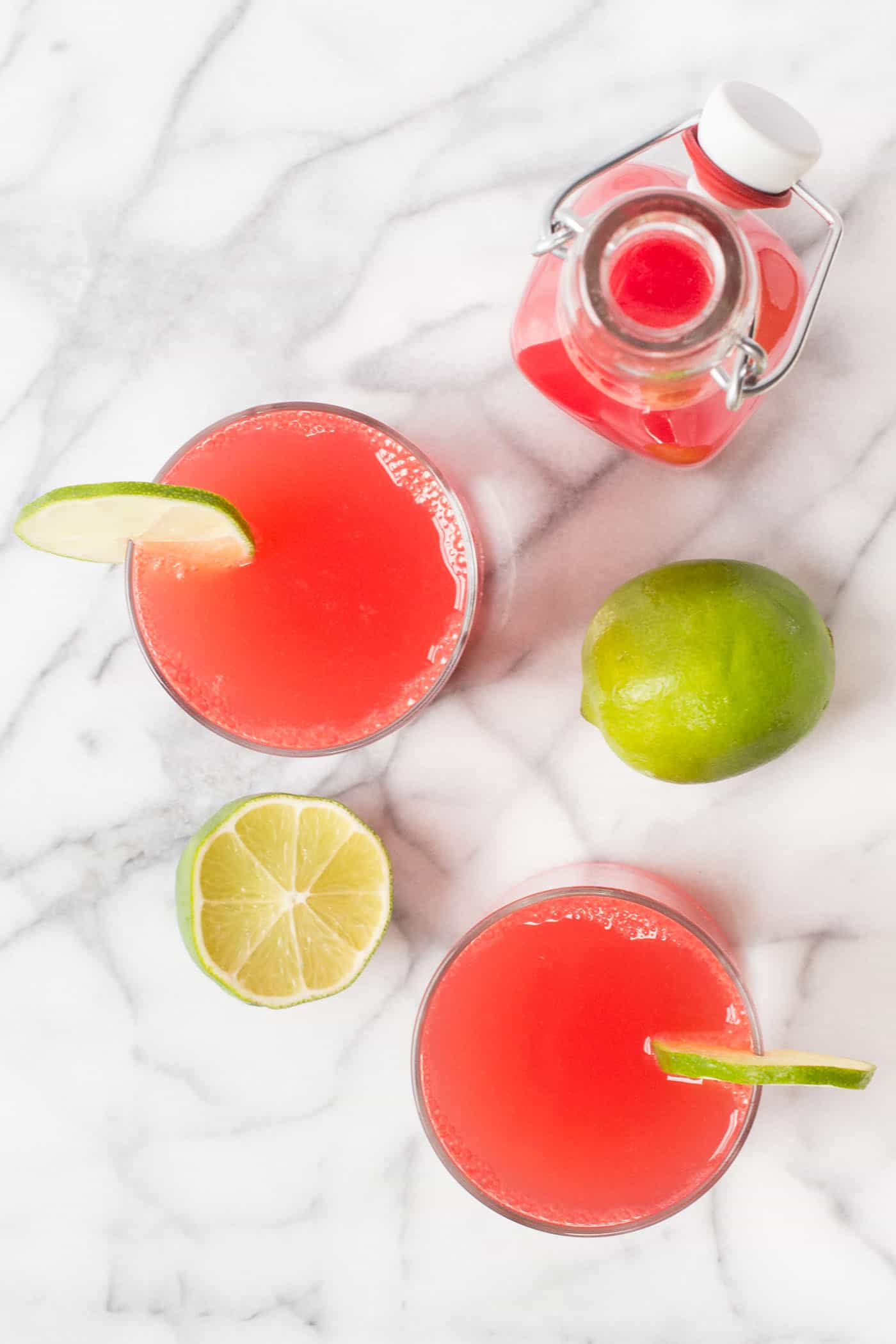 Looking for a healthy summer cocktail recipe? Try these Watermelon Lime Spritzers! They're only three ingredients, sweetened naturally, and are light, crisp and refreshing!