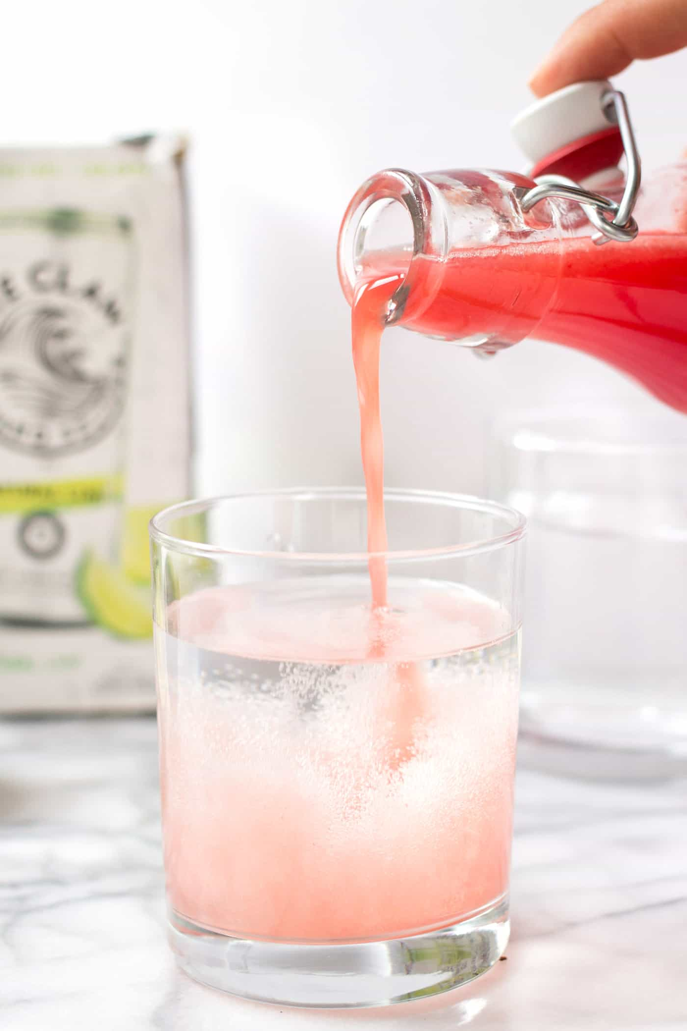 How to make healthy Watermelon Spritzers using fresh watermelon, limes + hard seltzer!