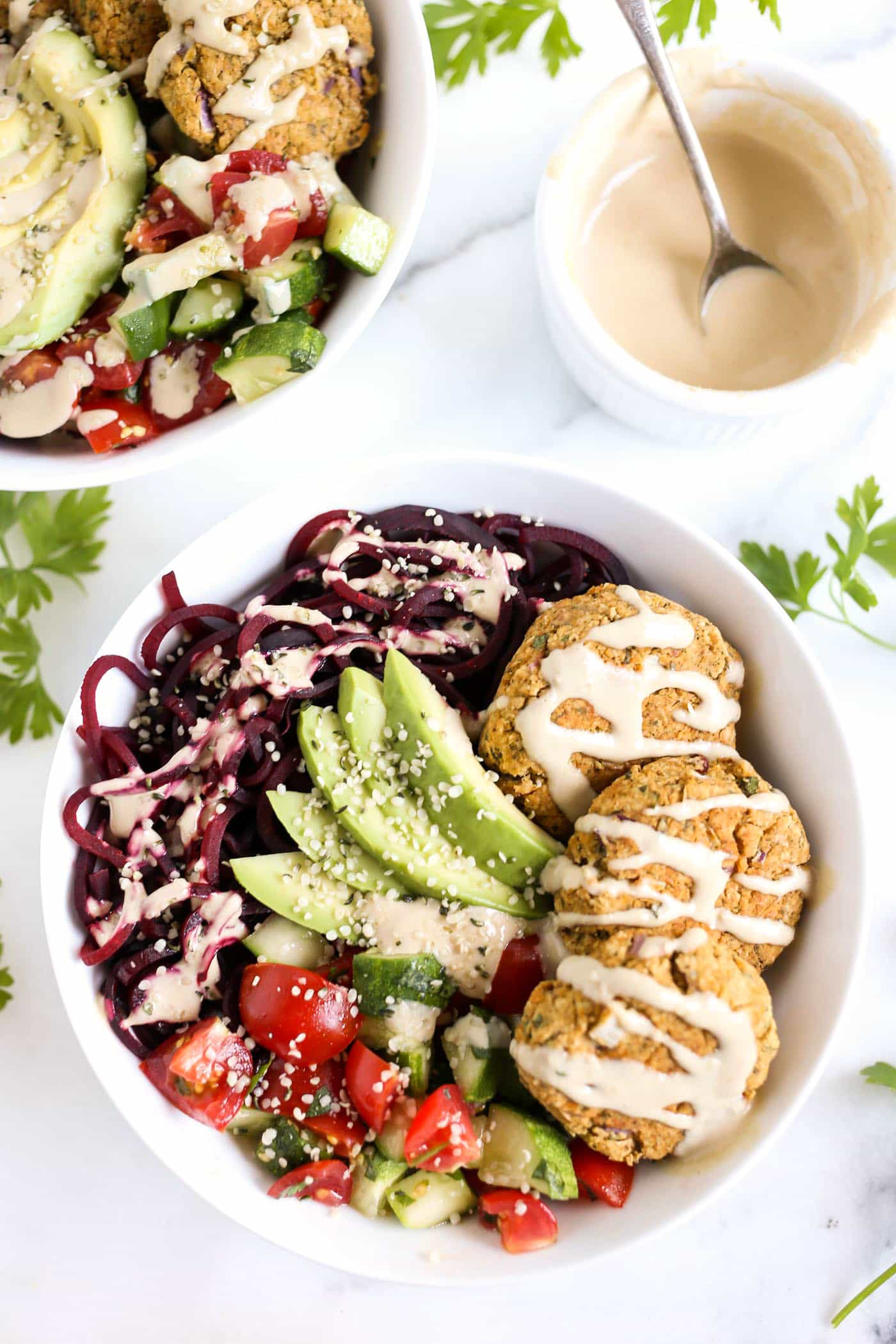 VEGETARIAN FALAFEL BOWLS with beet noodles. cucumbers, tomatoes and a creamy tahini dressing!