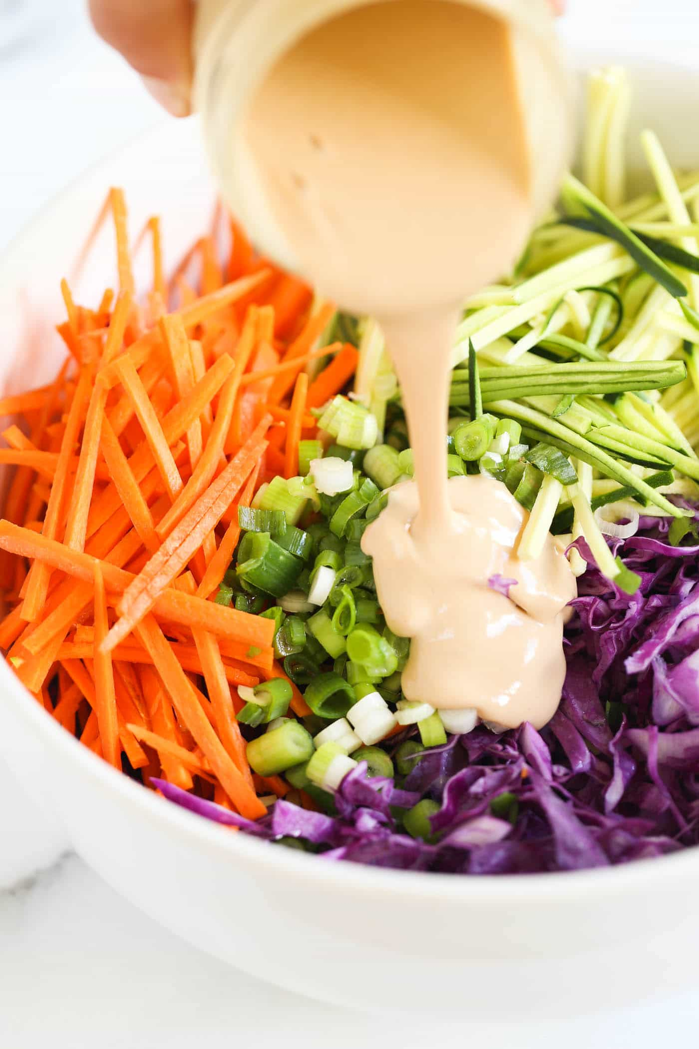 this MAYO-FREE coleslaw recipe uses tahini to make it ultra creamy and maple syrup to give it a bit of sweetness!