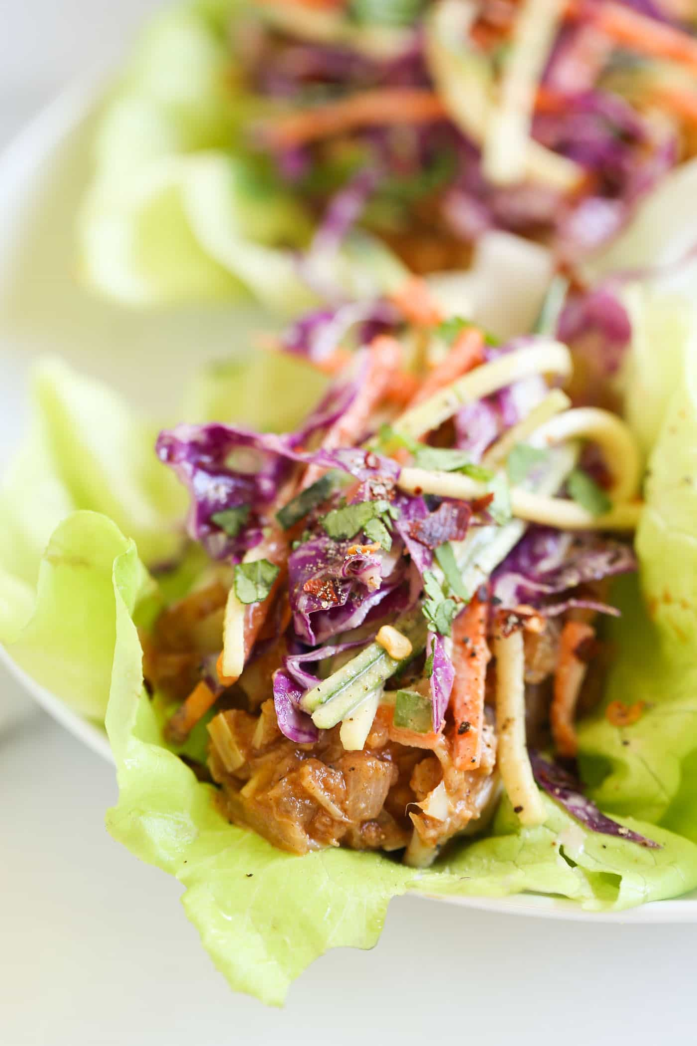 """BBQ Pulled Pork Lettuce Wraps that are made with a VEGAN """"pulled pork"""" recipe and topped with a maple coleslaw!"""