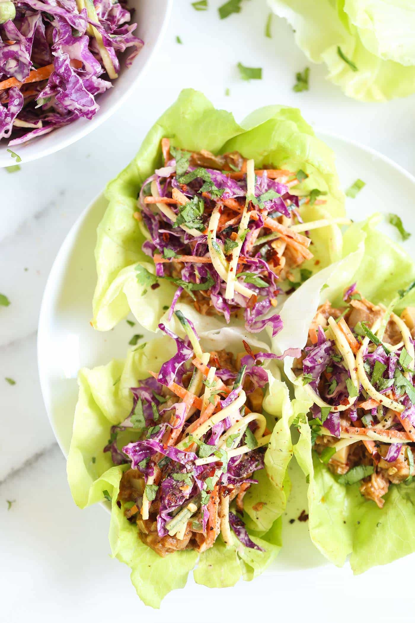 "BBQ Pulled Pork Lettuce Wraps that are made with a VEGAN ""pulled pork"" recipe and topped with a maple coleslaw!"