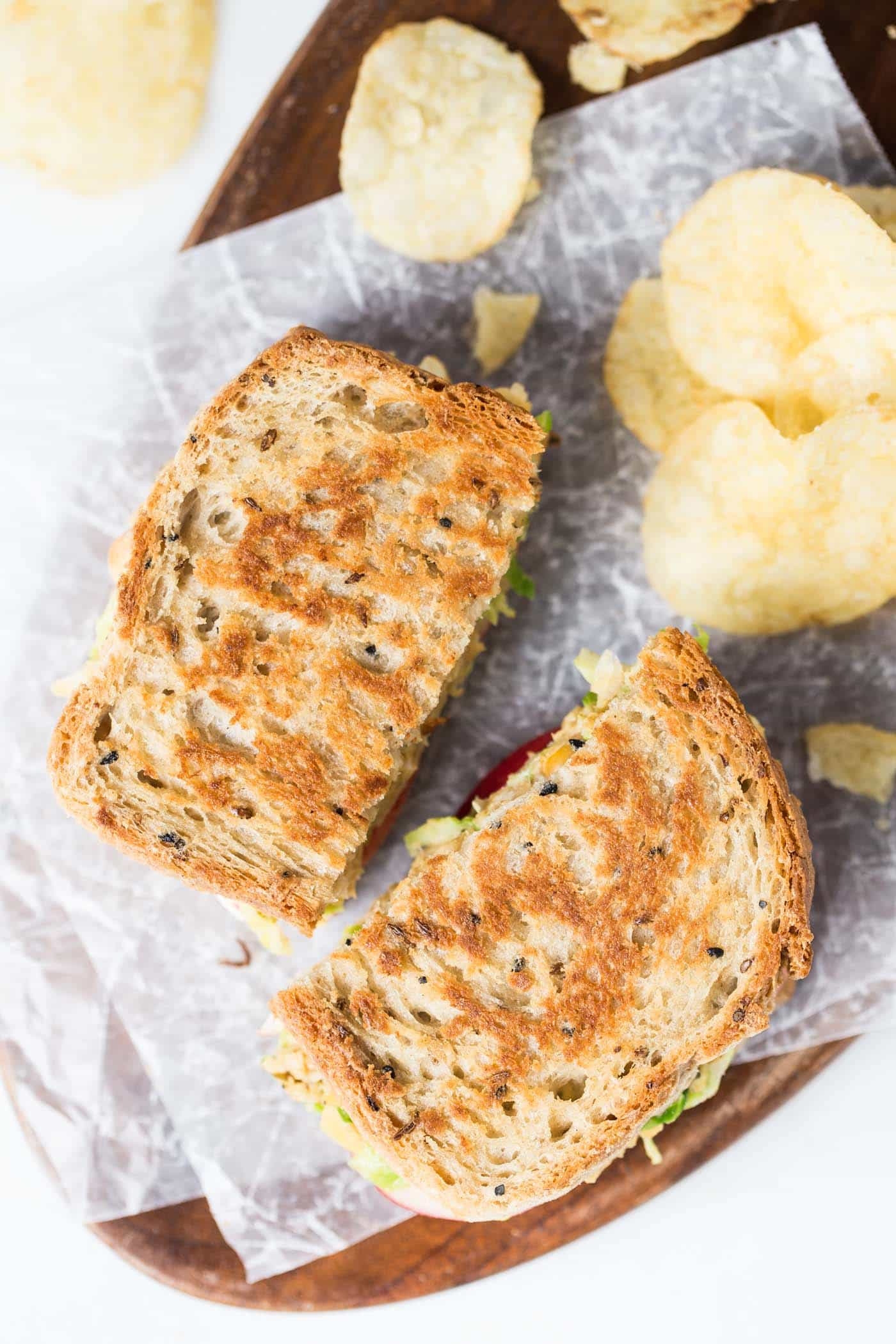 The perfect VEGAN Grilled Cheese -- with brussels sprouts + hummus for a plant-powered and protein-packed lunch!