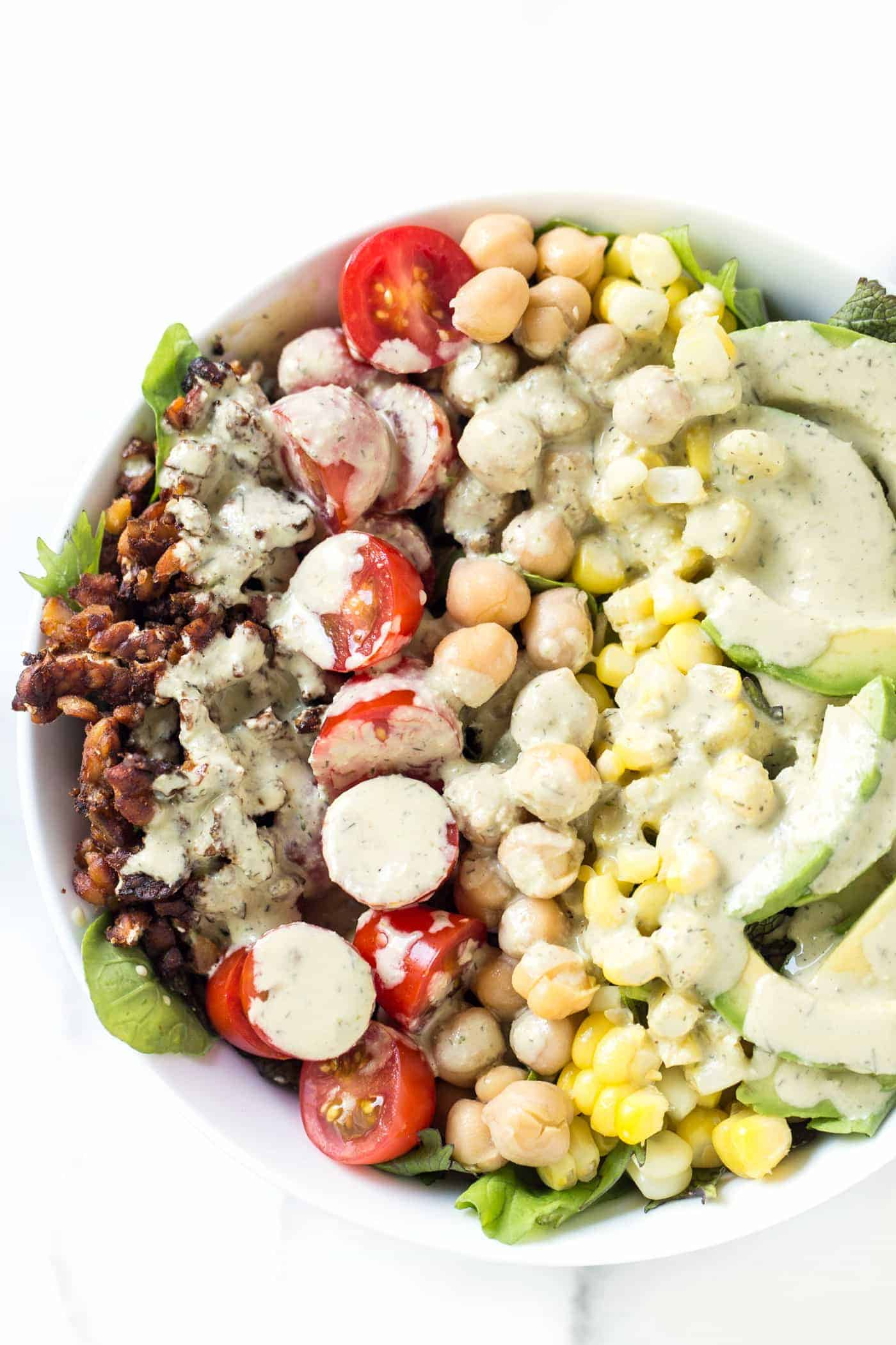 This easy VEGAN COBB SALAD replaces all the unhealthy ingredients with plant-based goodies! Including: tempeh bacon, chickpeas and a vegan ranch dressing!