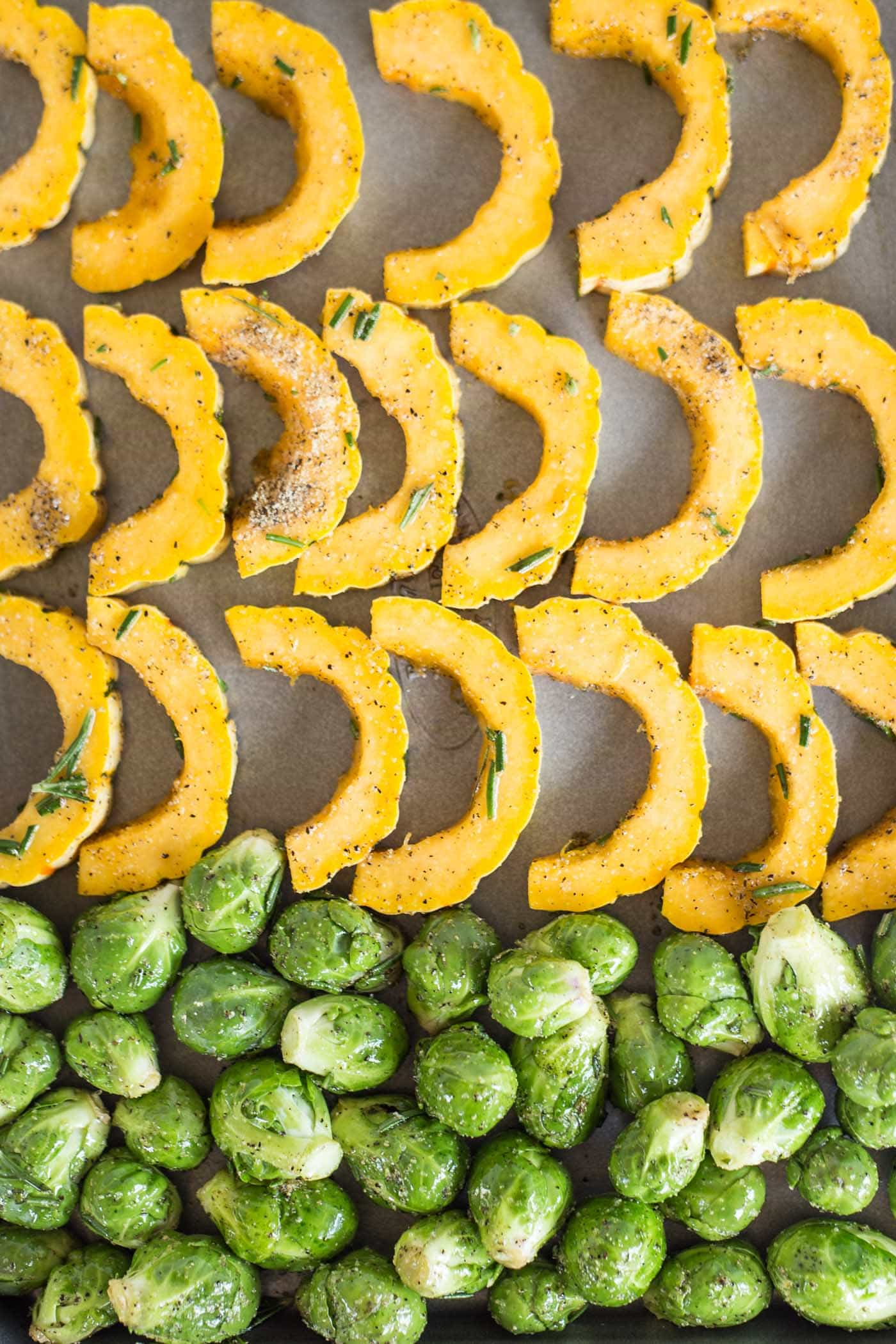 How to make a healthy quinoa buddha bowl with delicata squash and roasted brussels sprouts!