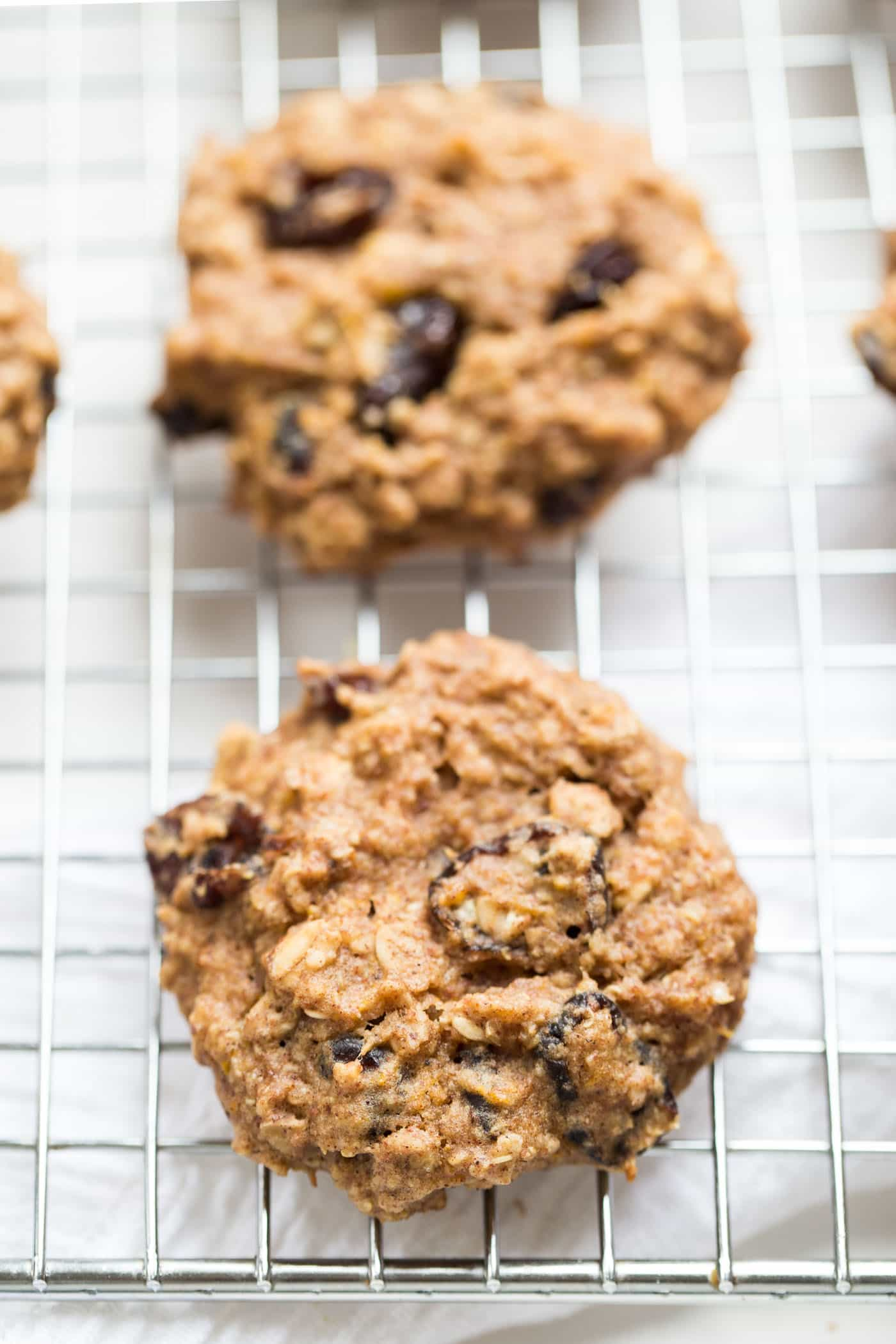 These Cranberry Orange Quinoa Breakfast Cookies double as a healthy breakfast or a decadent dessert! They'd be perfect for a holiday cookie swap!