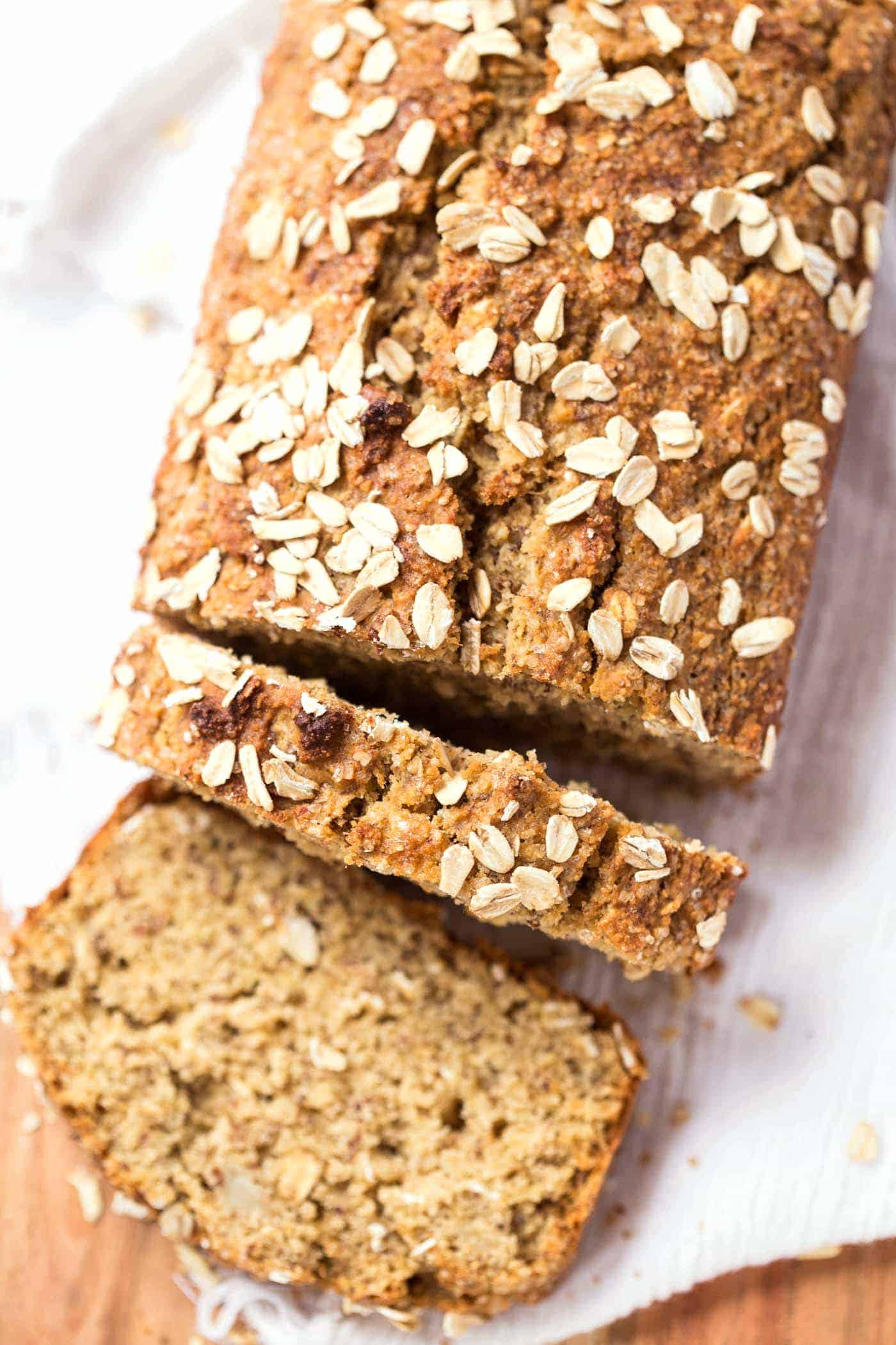 This HEALTHY Honey Oatmeal Banana Bread is packed with nutrient-dense flours, sweetened naturally and uses just one tablespoon of oil!