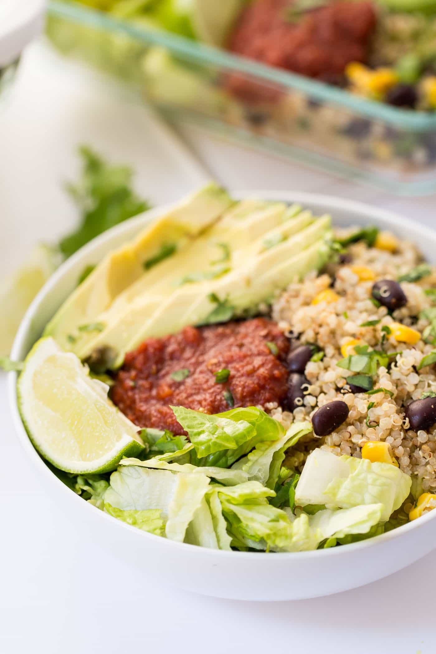 These easy vegetarian quinoa burrito bowls are the perfect recipe to meal prep for a healthy lunch or dinner. It makes 5 days worth of food in less than 20 minutes, is packed with nutrients and tastes delicious!