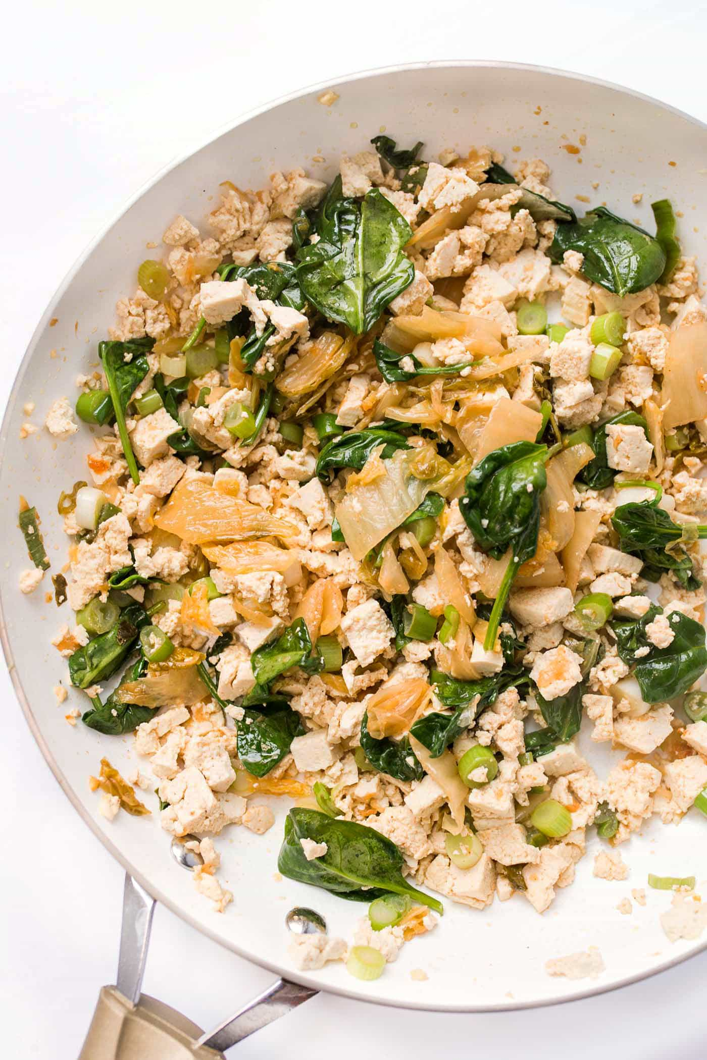 5-Ingredient Tofu Scramble in the making! With kimchi, spinach and green onions for crunch!