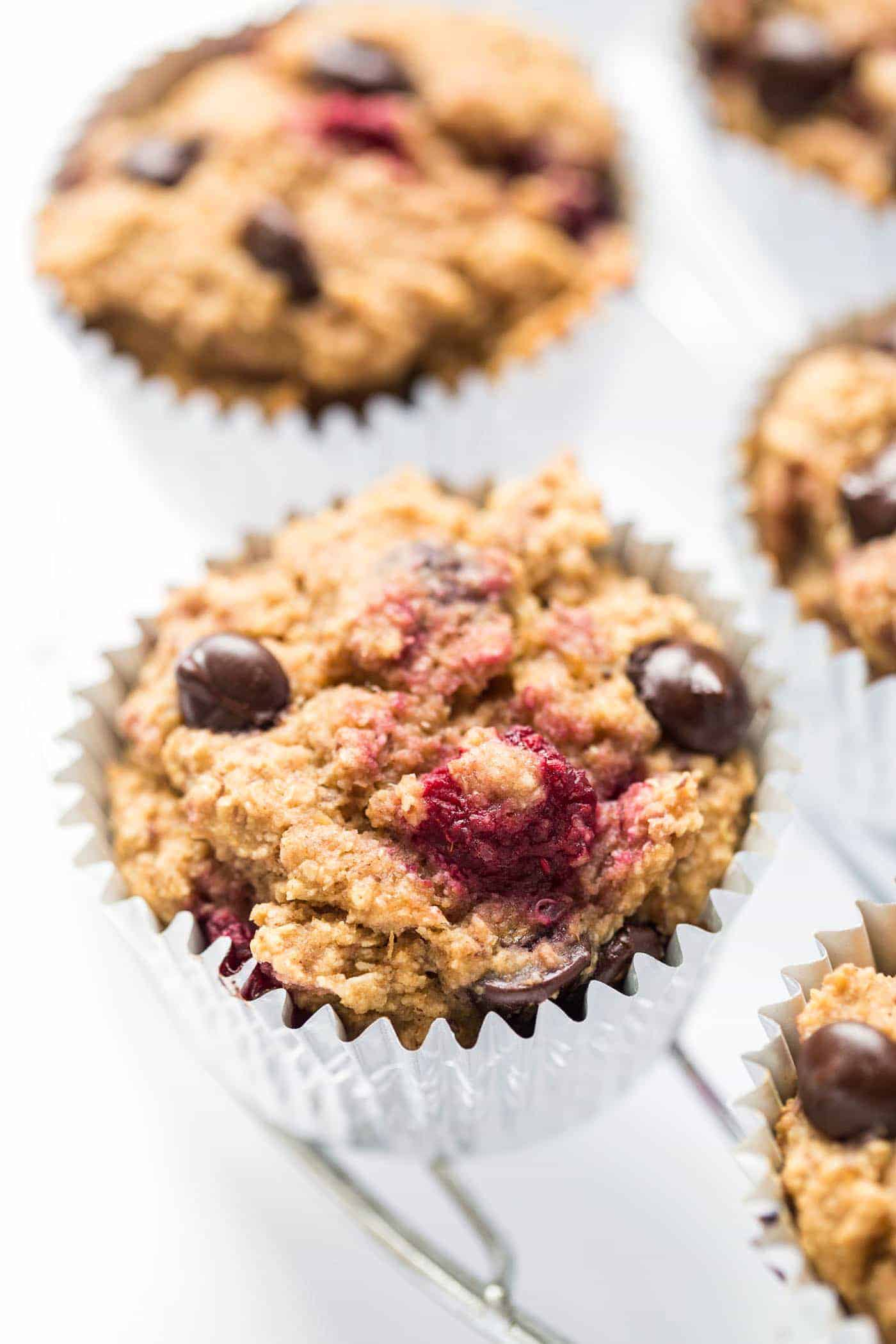 These SKINNY Raspberry Chocolate Chip Quinoa Muffins are made in just one bowl, packed with healthy ingredients and don't use any oil, eggs or dairy!