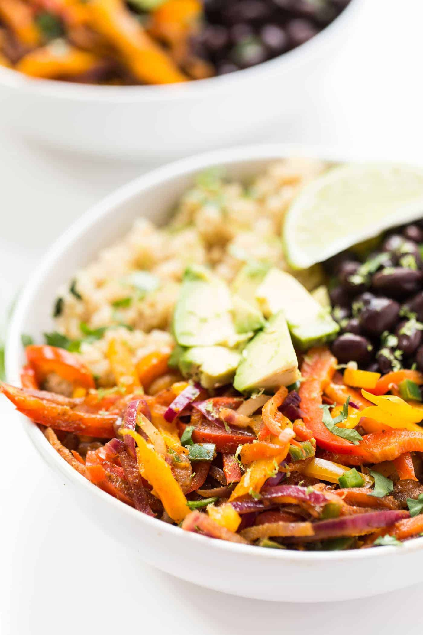 Black Bean Quinoa Fajita Bowls -- ready in just 20 minutes, this meatless meal is sure to make everyone happy!