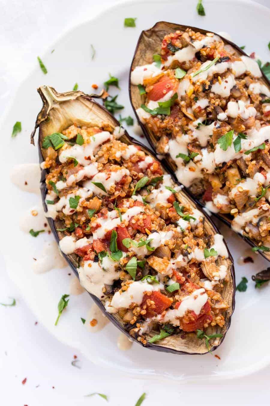Quinoa Stuffed Eggplant With Mushrooms Tomatoes And A Creamy Tahini Sauce On Top