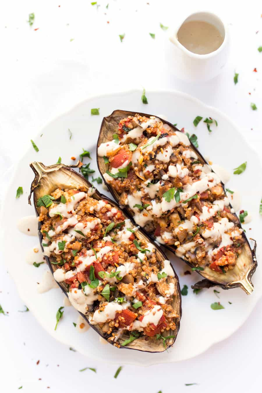 Quinoa Stuffed Eggplant - with mushrooms, tomatoes and a creamy tahini sauce on top! Ready in just 30 MINUTES!