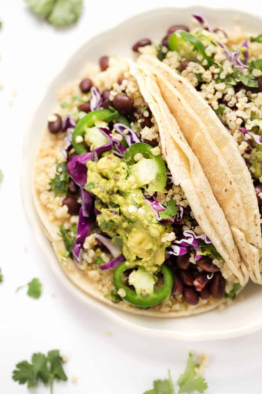 These healthy Cilantro Lime Black Bean Quinoa Tacos are the PERFECT recipe for summer! Light, flavorful, healthy and super SIMPLE! [vegan]