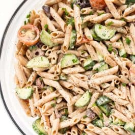 creamy mediterranean pasta salad with hummus and olives