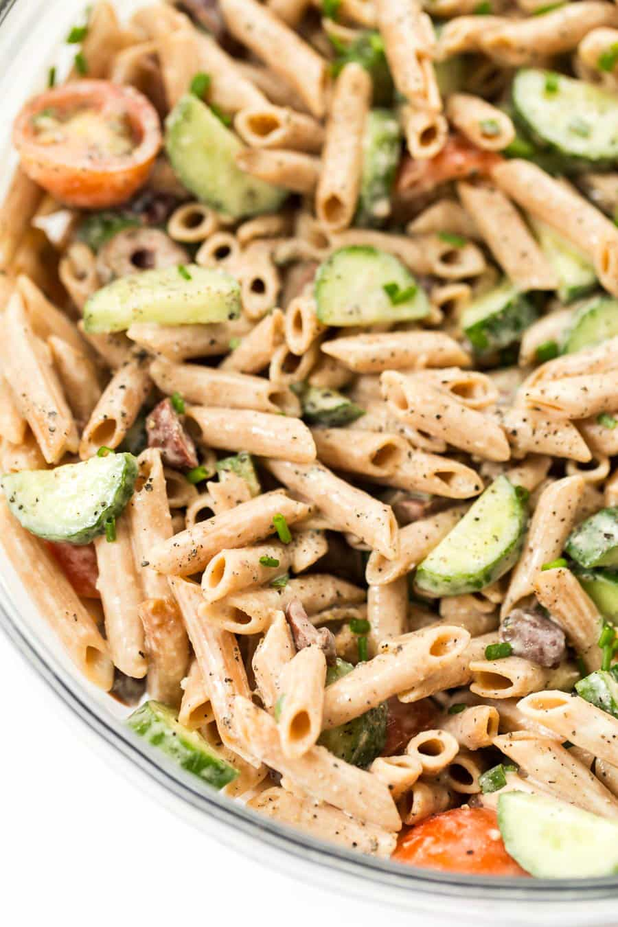 Looking for a healthy pasta salad to make? Try this Creamy Mediterranean Pasta Salad! It's made with veggies and tossed in a healthy creamy sauce!