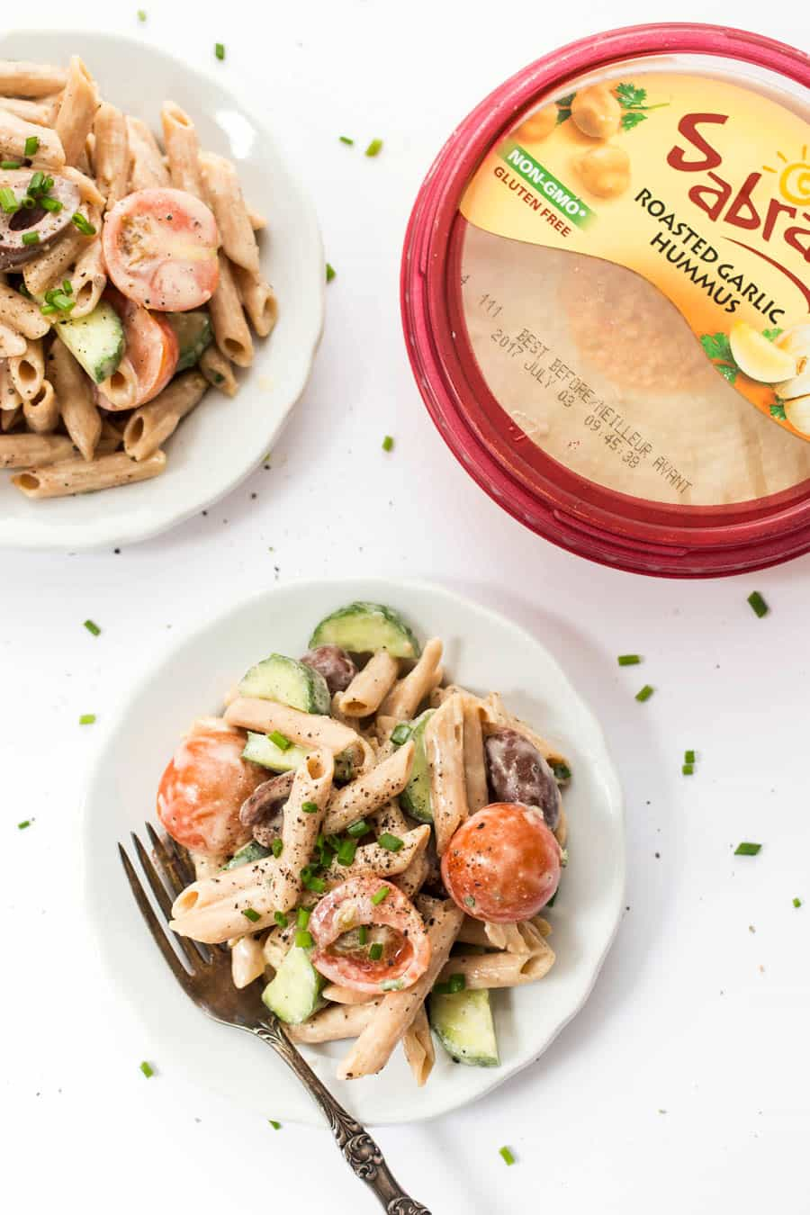 This CREAMY Mediterranean Pasta Salad is made with a delicious sauce and packed with veggies!