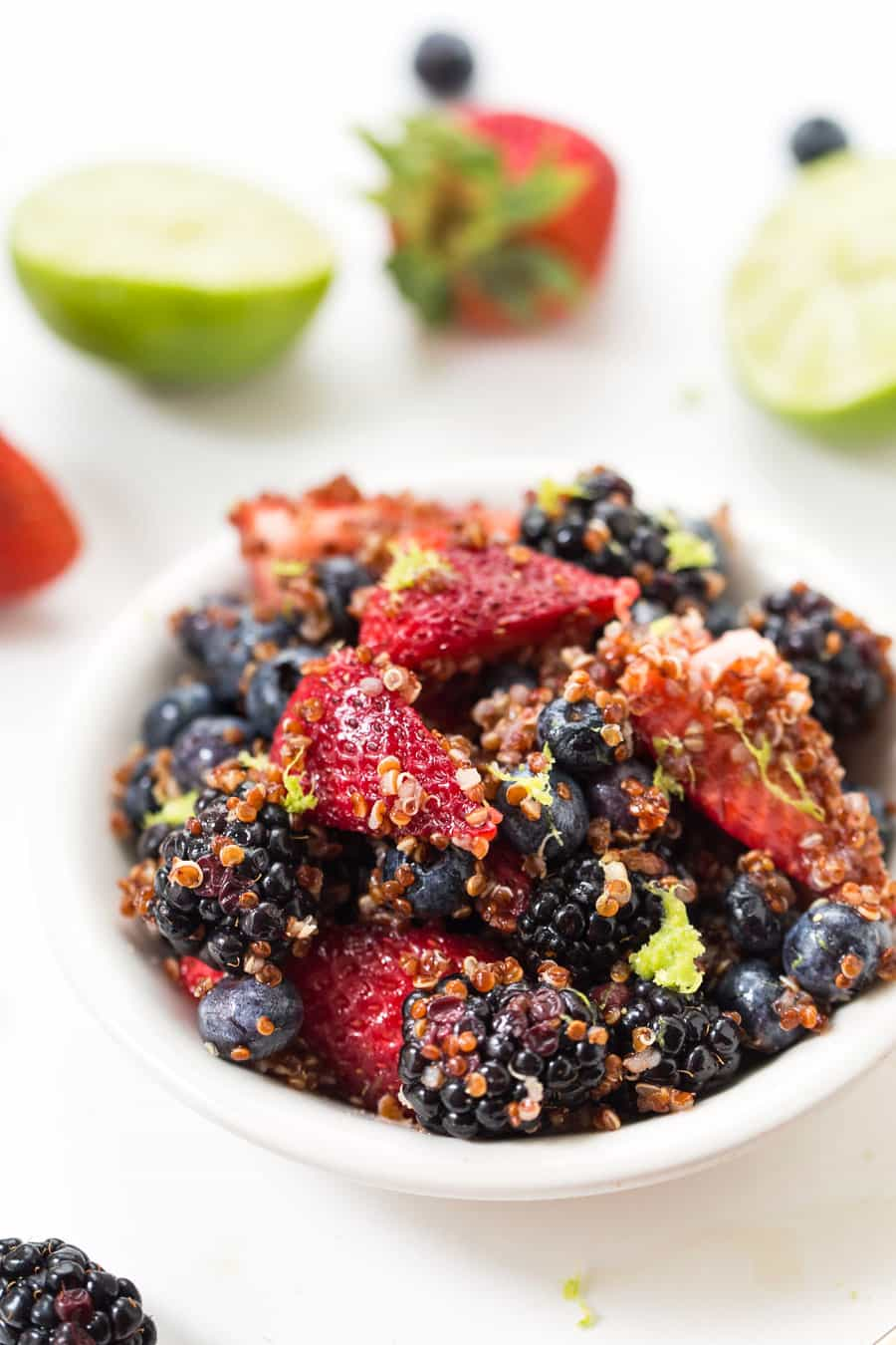 This TRIPLE BERRY QUINOA SALAD is tossed in a maple lime dressing and makes the perfect summer dessert (or breakfast!)