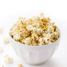 The BEST Vegan Popcorn! Made with just a few simple ingredients and packed with cheesy flavor!