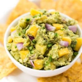 spicy mango guacamole with cilantro and onion