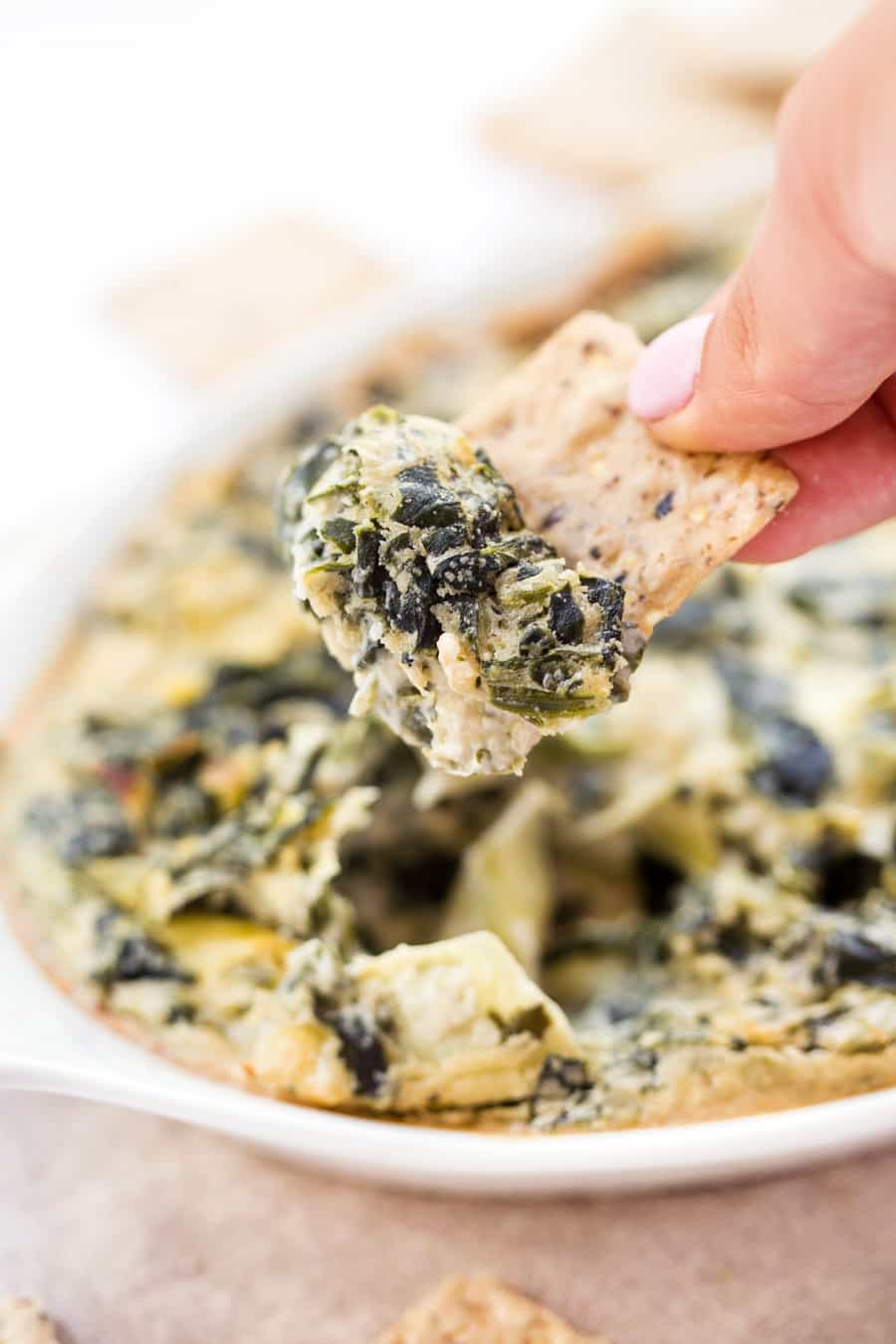 VEGAN SPINACH ARTICHOKE DIP -- made with less than 10 ingredients and ready in just about 30 minutes!