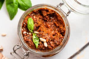 overhead of sun dried tomato pesto in a glass canning jar