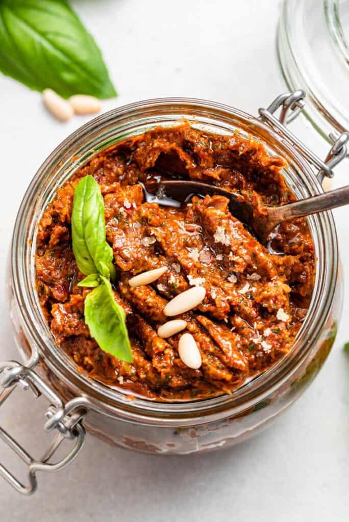 jar of sun dried tomato pesto with pine nuts